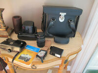 camera praktica avec 2 zoom,flash,trepied,case,valise,livret ins