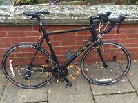 Carbon fibre frame road bike verenti insight 0.4 and turbo trainer