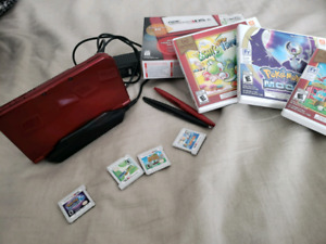 Almost new 3ds xl whit 4 gmaes and stand charge !