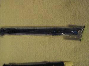 a black and white recorder flute in brand new condition