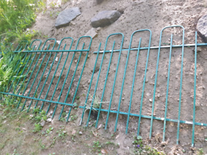 Green metal fence