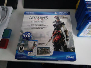 White Assassins Creed PS Vita + 8 Gig Card + Extra Cases