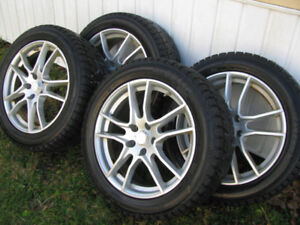 "4 used 18"" Winter Alloy Rims with snow tires already on"