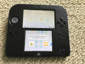 Nintendo 2DS with charger and 60 Games