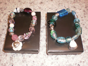 2 bracelets with boxes