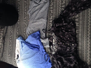 Tons of women's clothing!! Worn only once- tags still on