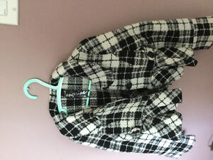 Selling a plaid black and white winter fabric jacket.