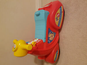 Fisher price sing and learn scooter brand new