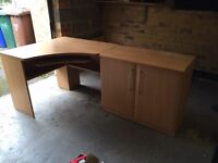 Office desk, cabinet and chair.