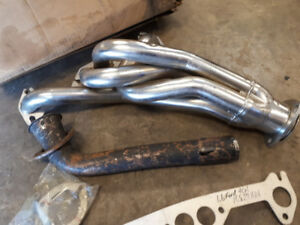 4 CYLINDER FORD 1.6 LITRE HEADER. NEW IN BOX $150.