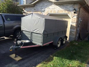 5'x10' covered tandem utility trailer