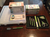 7 Cricut cartridges, cartridge storage container and tools