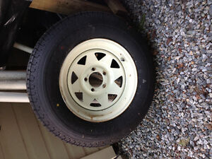 2 brand new trailer tires and rim