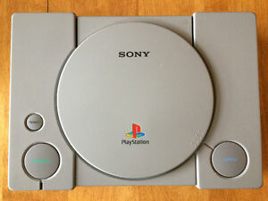SELLING SONY PLAYSTATION with 4 CONTROLLERS, 22 GAMES