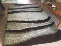 HAND Woven rug, 112 inch by 78 inch