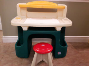 Step 2 desk for children and storage plastic drawers.