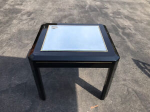 Beautiful pair of black side tables with glass