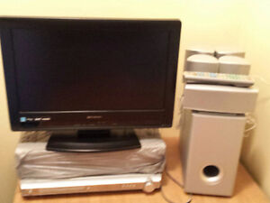 """19"""" EMERSON LCD TV PLUS DVD HOME THEATRE SYSTEM. $65.00 FOR ALL"""
