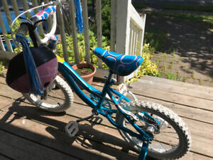 Girls bicycle and helmet like new for sale
