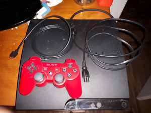 PS3 with wireless red controller and charging cord plus 5 games