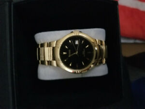 Pulsar watch gold tone with black face