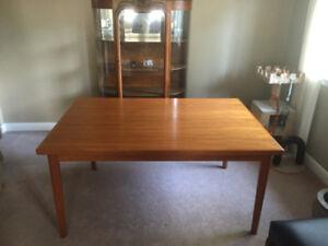 Danish teak draw-leaf dining table. Mid-century modern classic.
