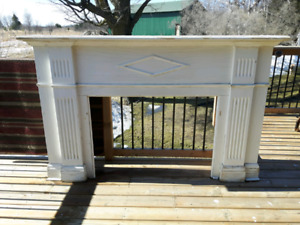 Antique fireplace surround and mantel