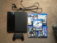 PlayStation 4 with 5 games and 1 controller
