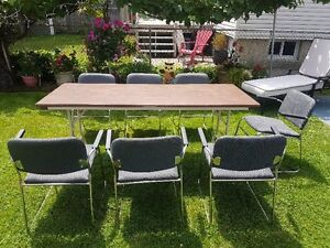 Very nice 7ft. folding table & 7 chairs, Very good condition