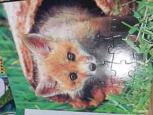 Set of three puzzle books London Ontario image 2