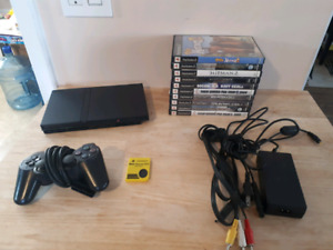 PS2 Slim System With A Controller, Memory Card And 10 Games!