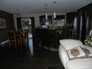 FOR RENT: Beautiful 2 bedroom home with on suite, May 1