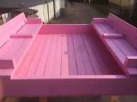 Covered sandbox with seats and picnic table