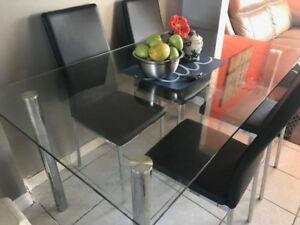 Brand new dining table with four chairs for sale because we are