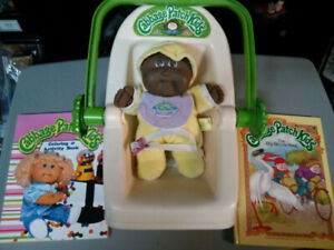 Cabbage Patch Kids lot1983 car seat / carrier, 2 books and