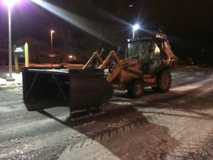 Backhoe for snow removal