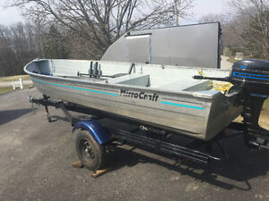 14' aluminum boat trailer and 9.8 merc