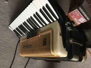 Italian full-size piano accordion and skb guitar case