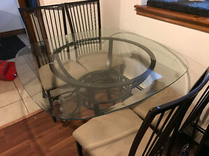 Glass table top + 4 chairs.