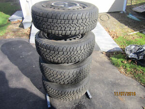 FOR SALE 4 Arctic Claw winter tires/rims and tire stand