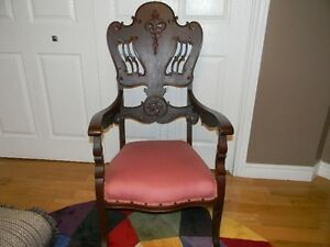 Beautiful accent chair with unique wood work grat condition only