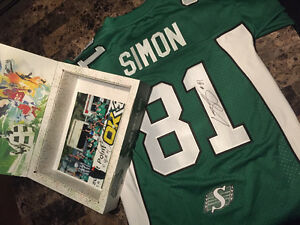 Signed Geroy Simon Rough Rider jersey with autographed picture