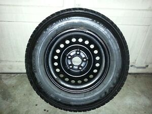 Four Toyo snow tires on steel rims