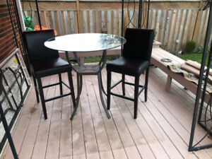 pub style table with 2 bar chairs