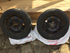 Two Winterforce Tires ON RIMS, almost NEW! 205 60R/16