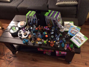 X BOX 360 4GB HD, 27 GAMES , 40 SKYLANDERS, 2 CONTROLLERS AND