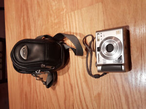 Panasonic Digital Camera with a good leather case.