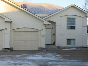 Millwoods Condo with garage for Rent in July