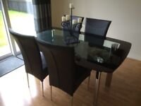 Glass dining table with chairs. IMMACULATE CONDITION