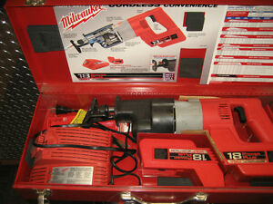 two millwaukee 18 vt battery sawzalls in cases w/accessories